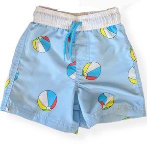 Light blue beach ball print swim trunks